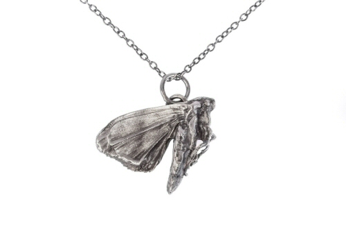 Moth in a hurry pendant.