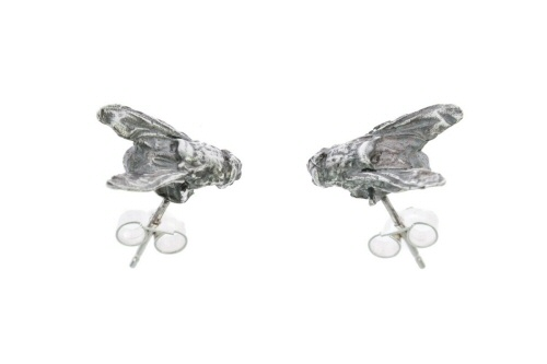 Fly stud earrings.