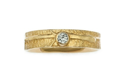 Leaf band with brilliant cut round diamond.