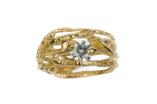Twig ring with organically set diamond.