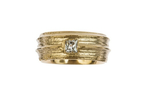 Gold cow parsley stem set with princess cut diamond.